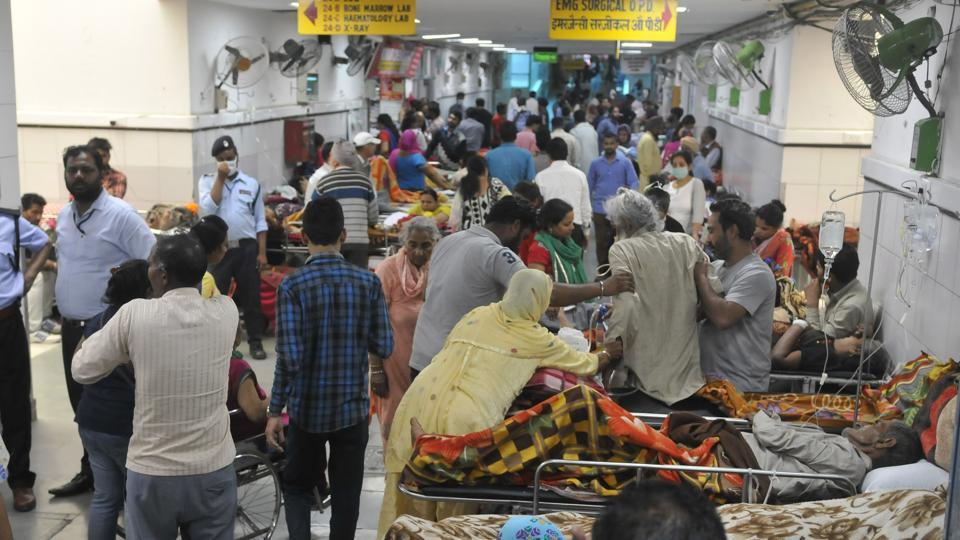 Patients, some critically ill, are accommodated in crowded passages of the PGIMER emergency, often with overworked doctors taking care of them.