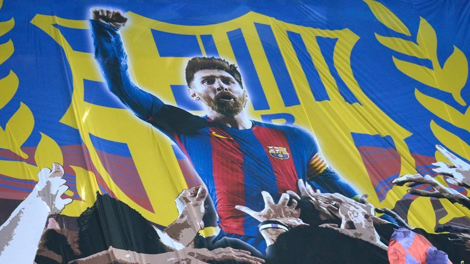 Barcelona supporters hold a giant banner depicting  Lionel Messi during the UEFA Champions League round of 16 second leg against Chelsea in Camp Nou. (AFP)
