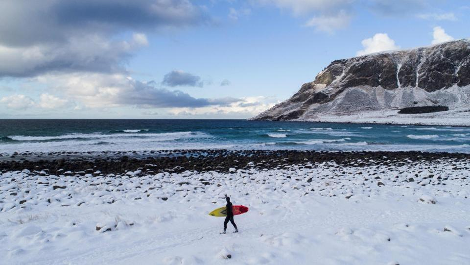 A surfer carries lugs board walking through snow out of the water in Unstad, Norway. Surrounded by breathtaking views of snow-covered mountaintops and cliffs dropping into the ocean, surfers and extreme sports enthusiasts looking for a unique experience come here from around the world; even in bone-chilling winters. (Oliver Morin / AFP)