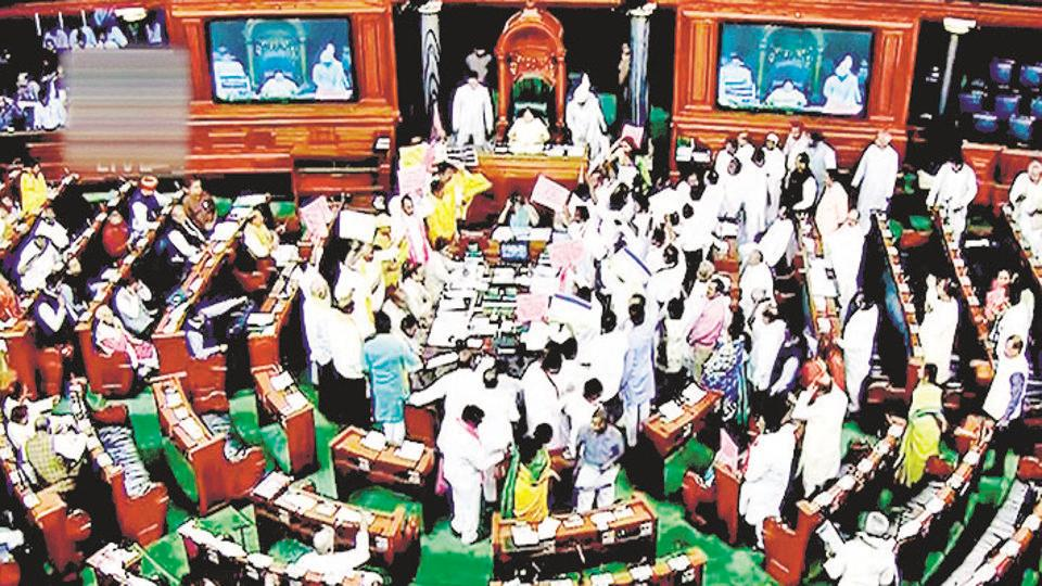 New Delhi: Opposition members protest during the ongoing budget session of Parliament in the Lok Sabha, in New Delhi, March 15