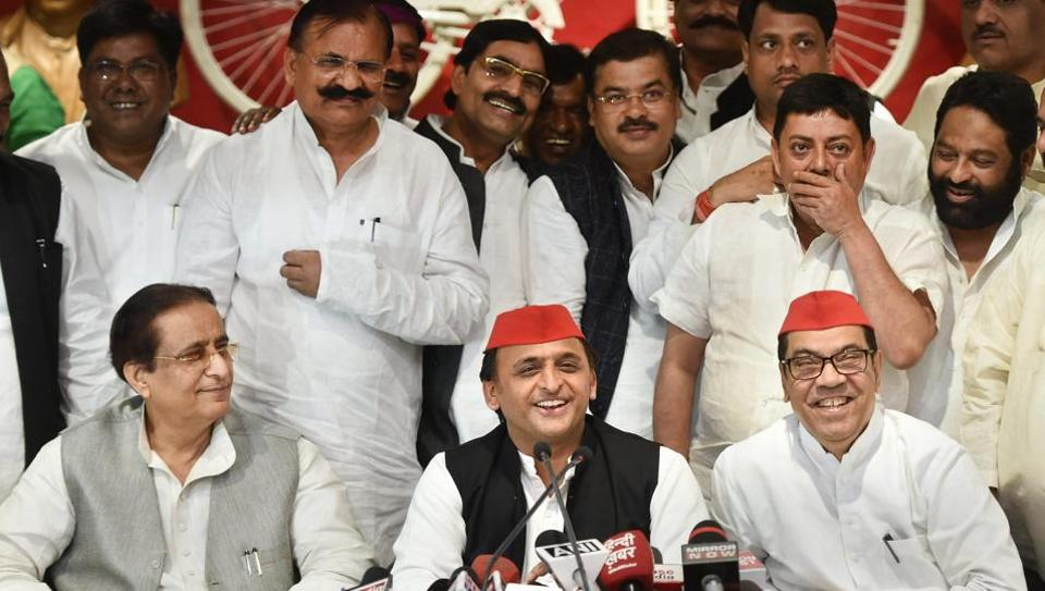 Samajwadi Party president Akhilesh Yadav with senior leaders Kiranmoy Nanda and Azam Khan addresses a press conference after the by-election results, at the party headquarters in Lucknow on Wednesday.