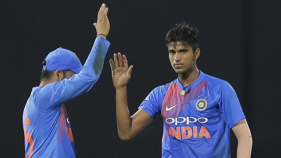 India's Washington Sundar (R) celebrates the the fall of a wicket with skipper Rohit Sharma during their Twenty20 match in the Nidahas Trophy triangular series vs Bangladesh in Colombo, Sri Lanka on March 12, 2018.