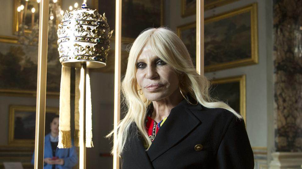 Donatella Versace poses next to one of the Tiara (1877) of pope Pius IX in Rome.
