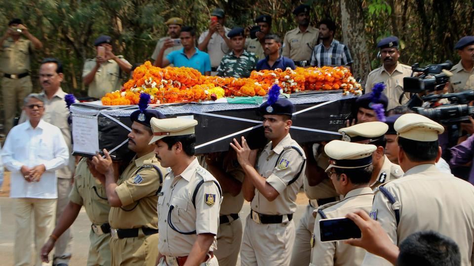 CRPF personnel carry a coffin containing the mortal remains of constable Manoranjan Lenka who was killed in an IED explosion in Sukma district of Chhattisgarh on March 13.