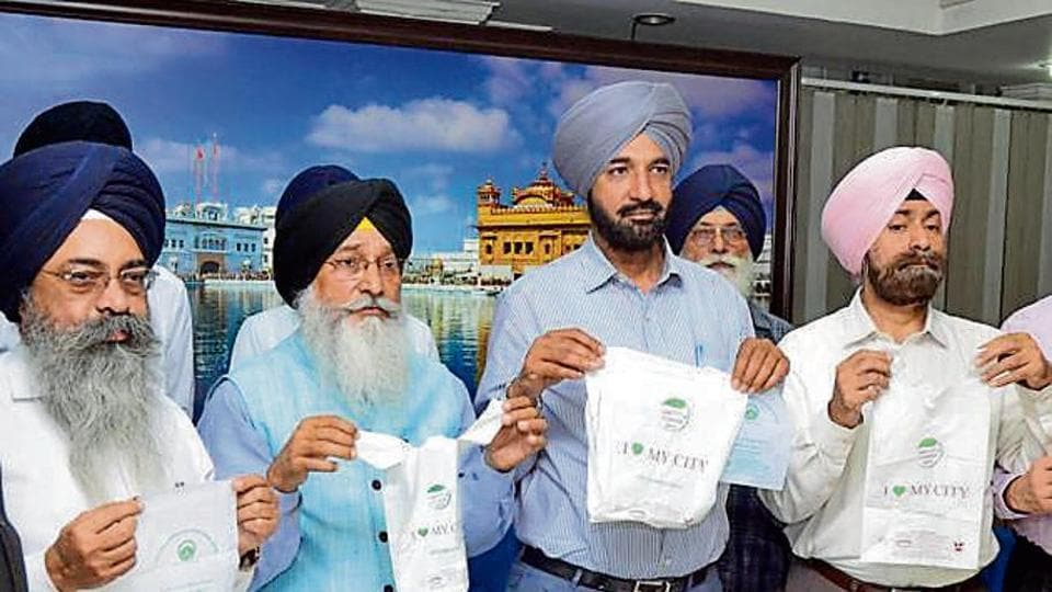 Members of PPCB and the SGPC launching the eco-friendly carry bags during a press conference on Thursday.