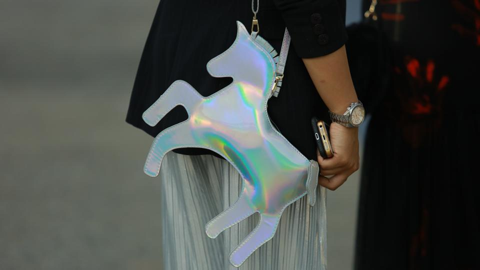 Holographic clutches were also seen at the venue.  (Photo: Amal KS/HT)