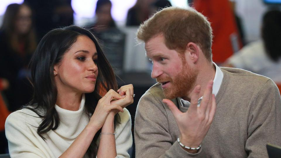 Britain's Prince Harry (right) and fiancee US actress Meghan Markle (left) attend an event in Birmingham.