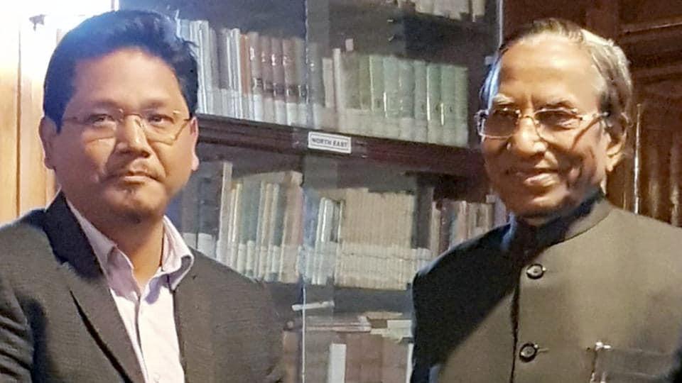 Meghalaya chief minister Conrad Sangma with governor Ganga Prasad at Raj Bhawan in Shillong.