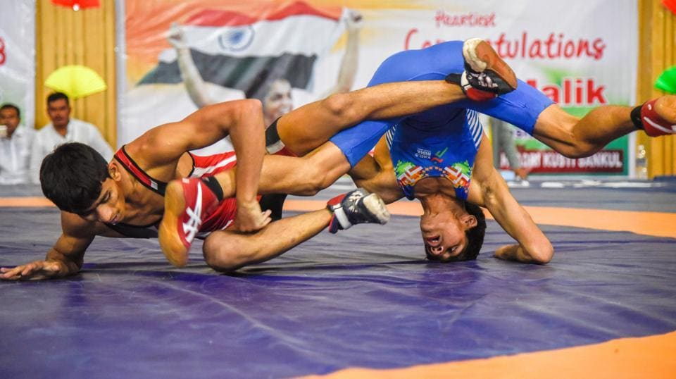 Solapur's Saurabh Igave of Maharashtra (red) in action against Aman of Haryana on the last day of the 37th sub-junior national wrestling at Shiv Chhatrapati sports complex in Balewadi. (sanket wankhade/ht PHOTO)