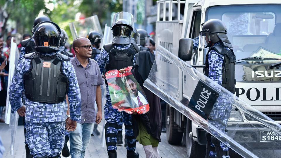 Afile photo shows Maldivian police responding to a protest urging the release of opposition leaders held in jail in the Maldives capital Male.