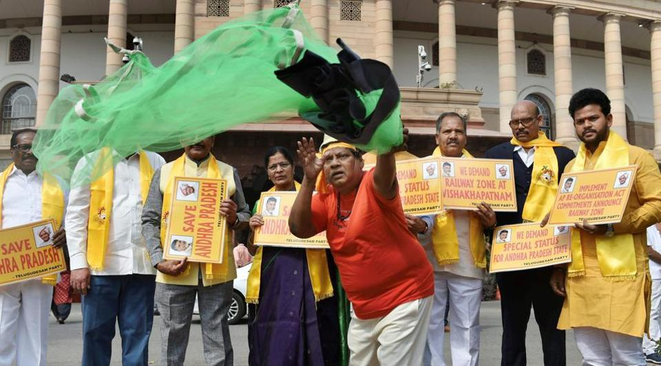 TDP MP Naramalli Sivaprasad, dressed as a fisherman, and other leaders demand special status for Andhra Pradesh at Parliament House on Friday.