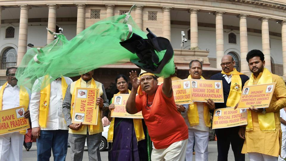 Telugu Desam Party (TDP) MP Naramalli Sivaprasad (R) and other leaders, protests demanding special status for Andhra Pradesh during the Budget Session of Parliament in New Delhi on Friday. The TDP on Friday formally decided to quit the NDA, days after two of its MPs resigned as ministers in the Narendra Modi government to protest the Centre's refusal of Special Category Status to Andhra Pradesh. (Vijay Verma /  PTI)