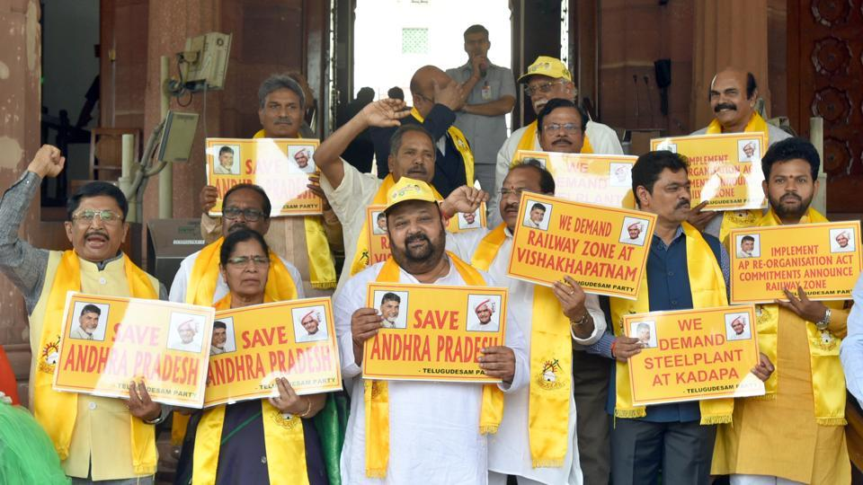 Telugu Desam Party members raise slogans demanding special status of Andhra Pradesh, at Parliament House in New Delhi, India, on Friday, March 16, 2018.