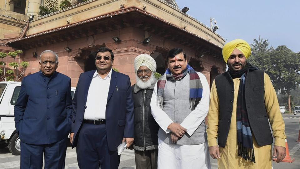 "Aam Aadmi Party (AAP) Rajya Sabha members Sanjay Singh (2R), Sushil Gupta (2L) and N D Gupta (L) with party Lok Sabha MPs Sadhu Singh (C) and Bhagwant Mann (R) at Parliament House. Bhagwant Mann resigned as the AAP Punjab unit president on Friday, a day after Arvind Kejriwal apologised to former Akali Dal minister Bikram Majithia for levelling ""unfounded allegations"" of his involvement in drug trade last year. (Kamal Singh / PTI File)"