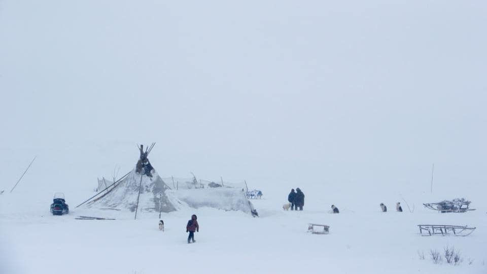 People are seen near a yurt tent at a reindeer camping ground somewhere in the Nenets Autonomous District. Kremlin politics and Moscow's six-lane motorways feel a world away in the Nenets Autonomous Region, 1,570 km northeast of the capital, where temperatures can drop to -40 degrees Celsius. (Sergei Karpukhin / REUTERS)