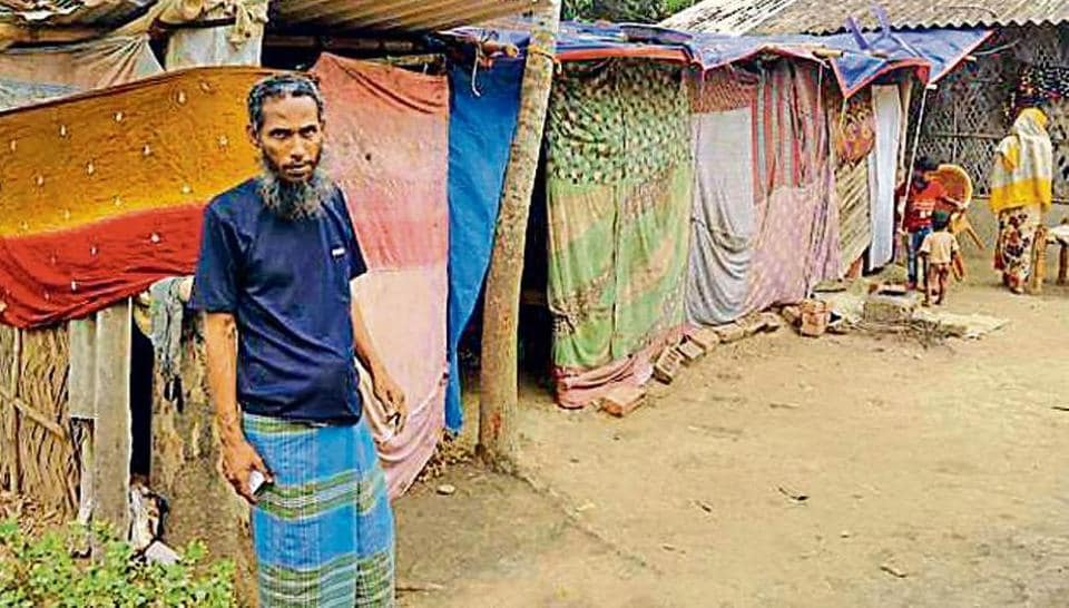 Rohingya refugee Azizullah stays with his family in thatched tents made up of old saris and polythene sheets in Hardaha.