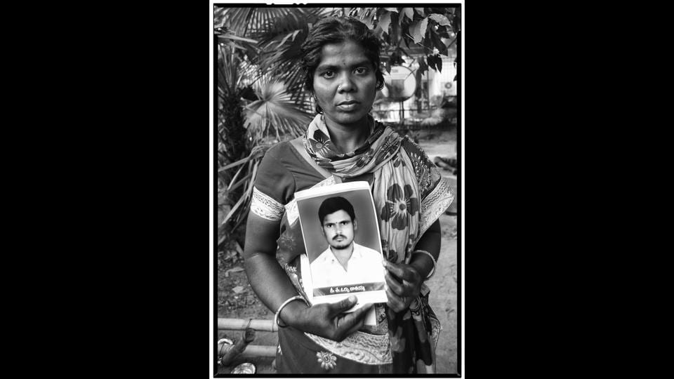Kavitha with a photo of her husband Orssu Kasayya, a tenant farmer from Chintakuntla village in Telangana. Vijay Jodha says that for him, a primary function of documentary photography is to create a record. His 'The First Witnesses' series is telling of the gigantic scale of the agrarian crisis in India. (Vijay Jodha)