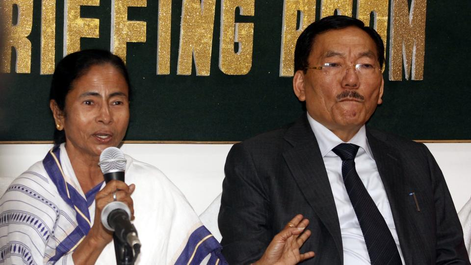 Bengal chief minister Mamata Banerjee sharing a light moment with Sikkim chief minister Pawan Chamling at a media conference in Siliguri on Friday.