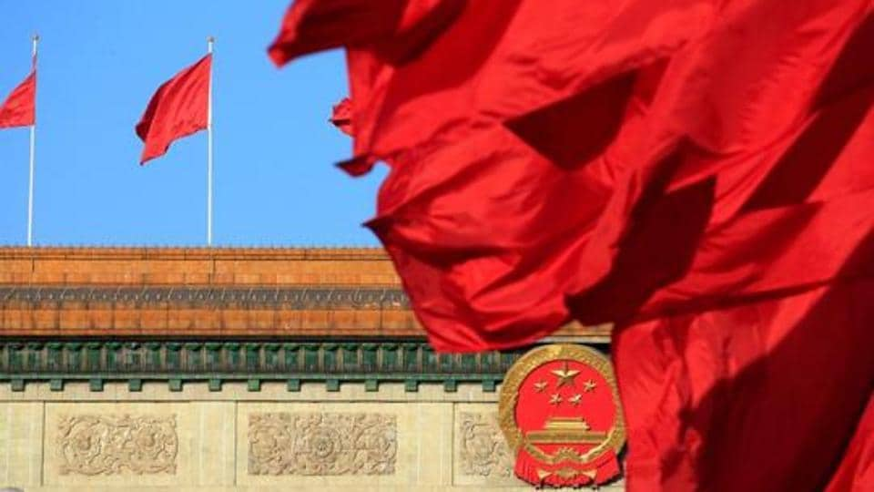 Red flags flutter outside the Great Hall of the People before the second plenary session of the Chinese People's Political Consultative Conference (CPPCC) in Beijing, China, on March 8, 2018.