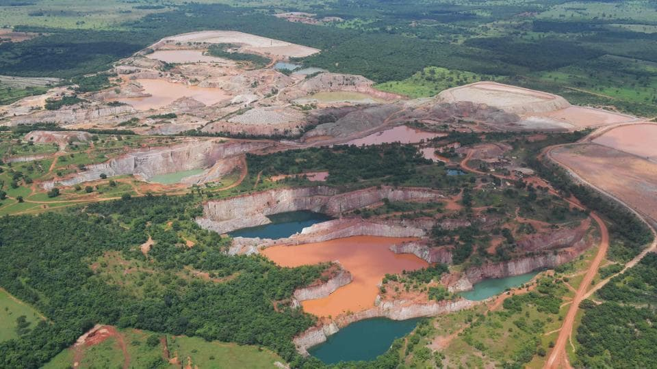 "An aerial view of mining activity at the Pantanal wetlands. The region also plays an important role in controlling the climate, says Sergio Freitas, who studies the region at the University of Brasilia. ""The surface functions as a big mirror made of water, reflecting part of the heat back and making the climate more agreeable,"" he said. (Carl De Souza / AFP)"