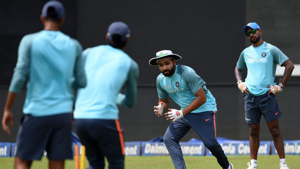 Indian cricket captain Rohit Sharma (2R) during fielding practice on the eve of the final. (AFP)