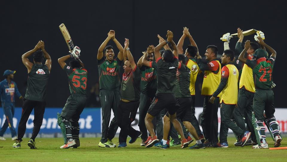 Bangladesh's team members perform a nagin dance as they celebrate their victory over Sri Lanka in the tri-nation Nidahas Trophy at the R. Premadasa stadium in Colombo on March 16.