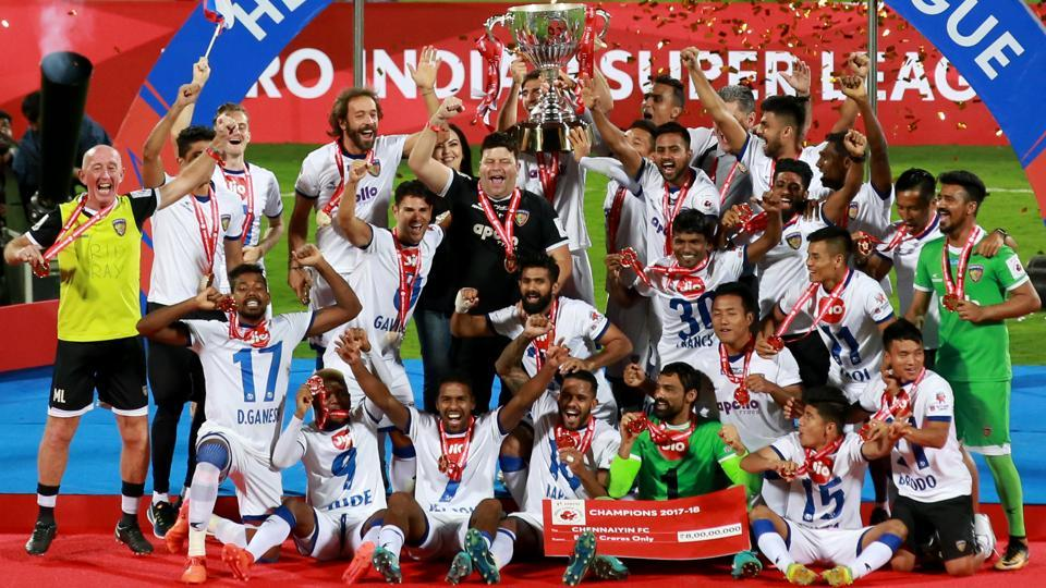 Chennaiyin FC players receiving the ISL 2017-18 cup after wining the final of the Indian Super League between Bengaluru FC and Chennaiyin FC held at the Sree Kanteerava Stadium, Bangalore on 17th March, 2018.  (ISL / SPORTZPICS)