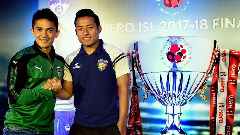 Bengaluru FC skipper Sunil Chhetri shakes hands with his counterpart Chennaiyin FC's Jeje Lalpekhlua during a pre-Indian Super League (ISL) final press conference in Bengaluru on Friday.