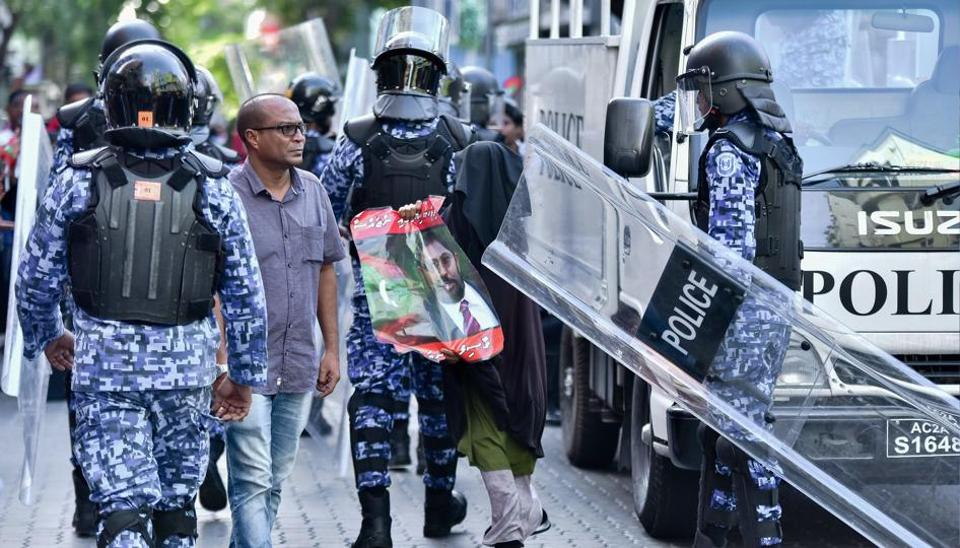 This picture taken on March 2, 2018 shows Maldivian police responding to a protest urging the release of opposition leaders held in jail in the Maldives capital Male.