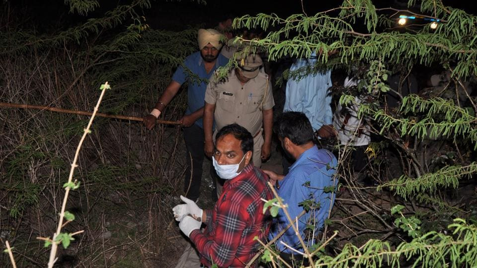 Forensic team inspecting the spot where dead body of Mohali resident was found, near village Choki in Panchkula.