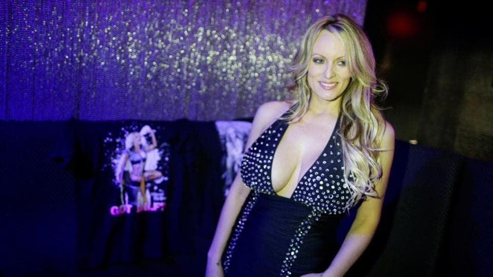Adult-film actress Stephanie Clifford, also known as Stormy Daniels, poses for pictures at the end of her striptease show in Gossip Gentleman club in Long Island, New York.