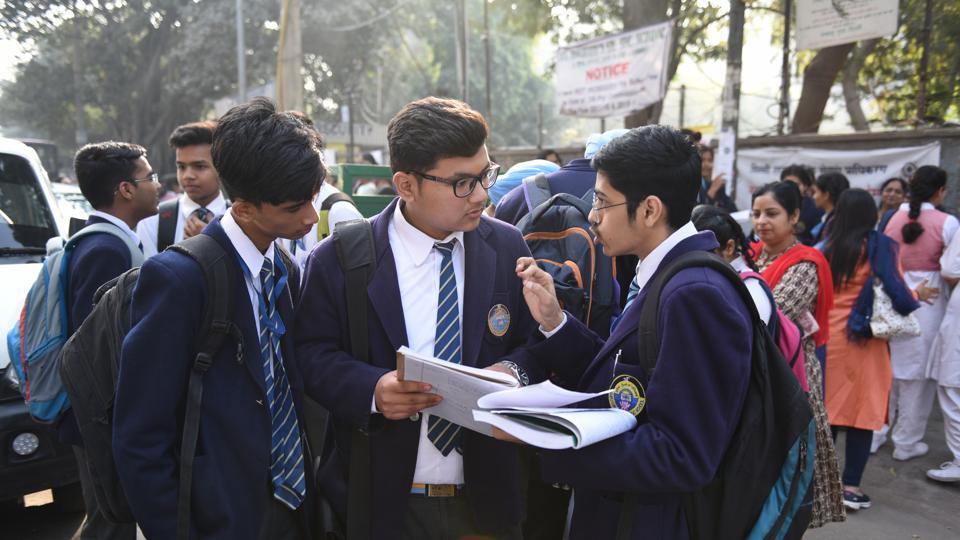 Students are seen doing their last minute revision, outside their examination centre in New Delhi.