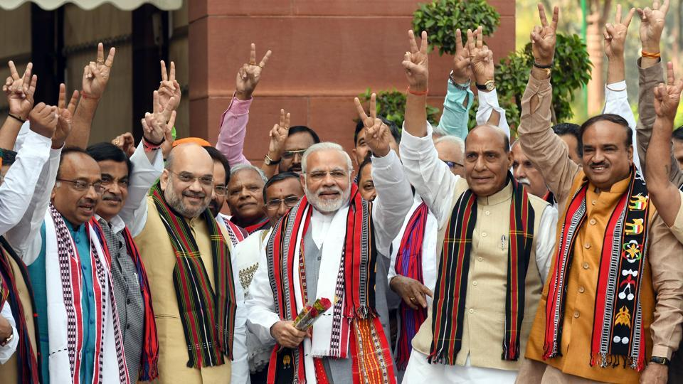 Prime Minister Narendra Modi with BJP leaders Amit Shah, Rajnath Singh, Vijay Goel, Ananth Kumar and other ministers pose for a photograph after the party's victory in the assembly elections in the northeast, at Parliament House on March 5, 2018.
