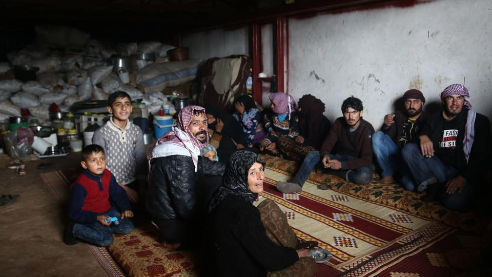 People take cover in a cellar in the village of Qastal Koshk, north of Afrin on March 16, 2018, amid battles between Turkish-backed forces and Kurdish fighters.