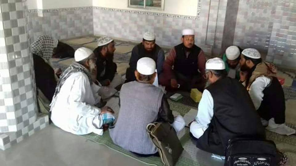 Mojaffar Khan, president of the association and imam of Domkal-Bilashpur mosque, speaks to a gathering against cheating in examinations.