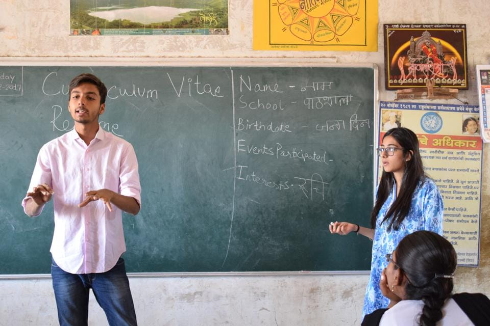 Students from HR College teach at a rural college.