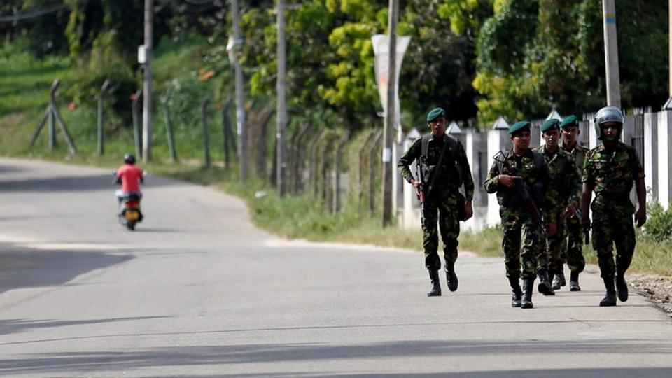 Sri Lanka Special Task Force soldiers patrol along a road after a clash between two communities in Digana, central district of Kandy, Sri Lanka March 8, 2018.