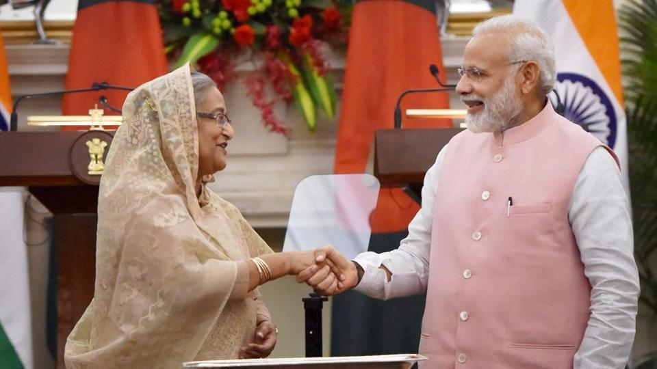 Prime Minister Narendra Modi shakes hands with his Bangladeshi counterpart Sheikh Hasina after flagging off an Indo-Bangladesh train service, at Hyderabad house in New Delhi.
