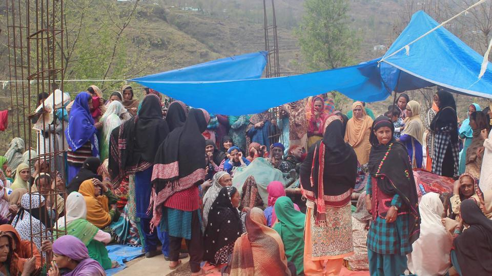 Villagers mourn the death of five members of a family killed in shelling by the Pakistani army along the LoC in Balakote sector of Poonch in Jammu on Sunday.
