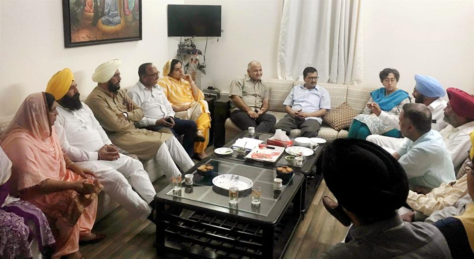 Delhi chief minister Arvind Kejriwal and deputy chief minister Manish Sisodia with Punjab AAP MLAs during a meeting at Sisodia's residence in New Delhi on Sunday.