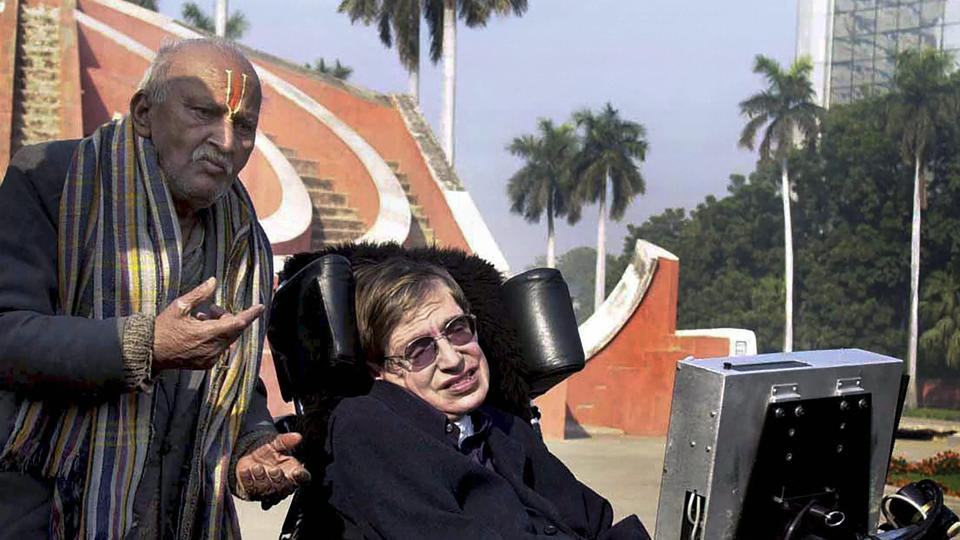 In this file photo dated January 15, 2001, a guide explains to Stephen Hawking how the monuments at Jantar Mantar were used for astronomy in New Delhi.