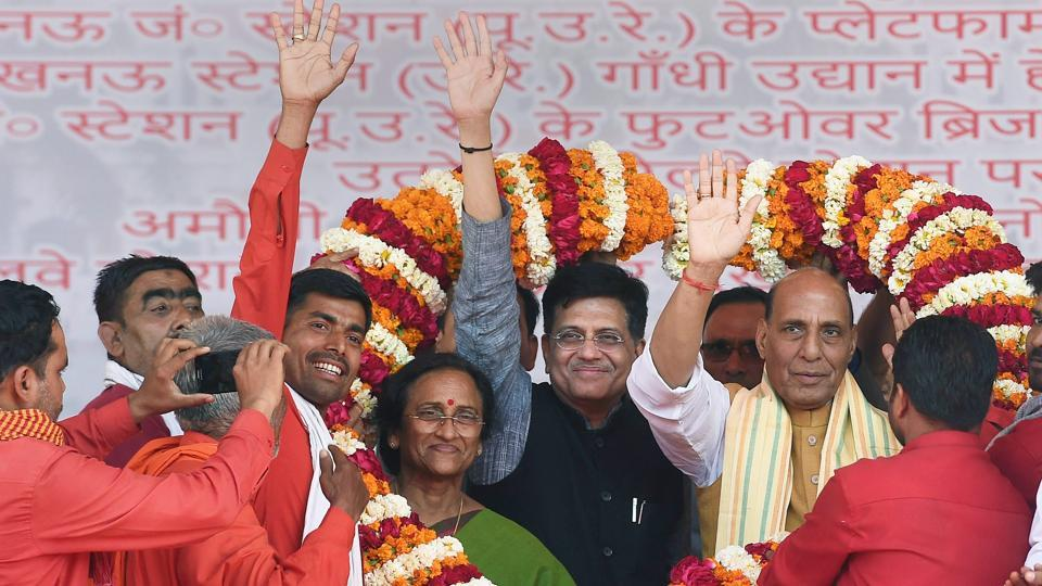 Union home minister Rajnath Singh and railway minister Piyush Goyal being presented a garland during the inauguration and foundation laying ceremony of various projects in Lucknow on Sunday.