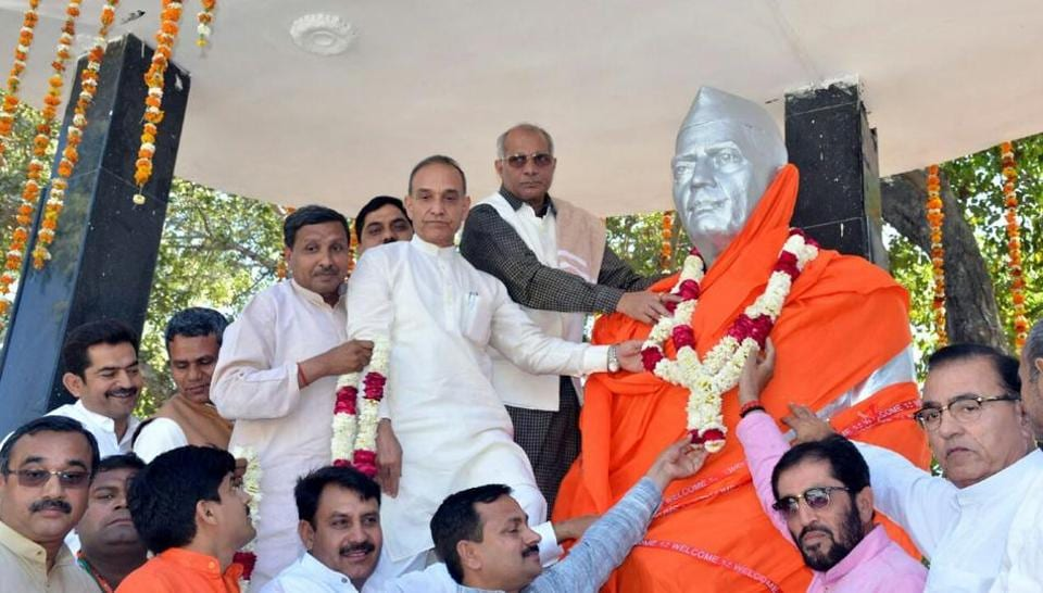 Union minister Satyapal Singh and UP minister for irrigation Dharmpal Singh unveil former PM Chaudhary Charan Singh's statue wrapped in a saffron cloth at Baraut town of Baghpat on Saturday.