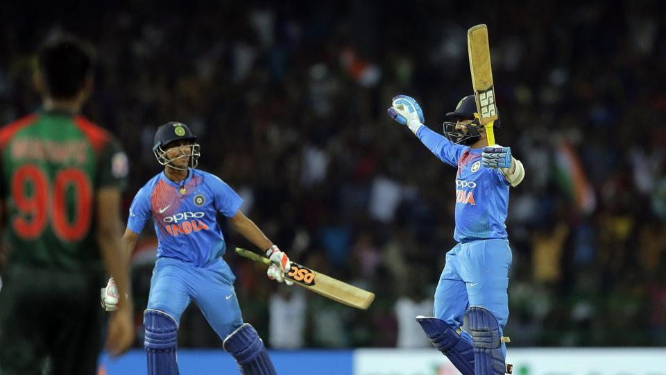 India's Dinesh Karthik, right, celebrates scoring the winning runs to defeat Bangladesh by four wickets during the final of the Nidahas Trophy triangular Twenty20 cricket series in Colombo on Sunday.