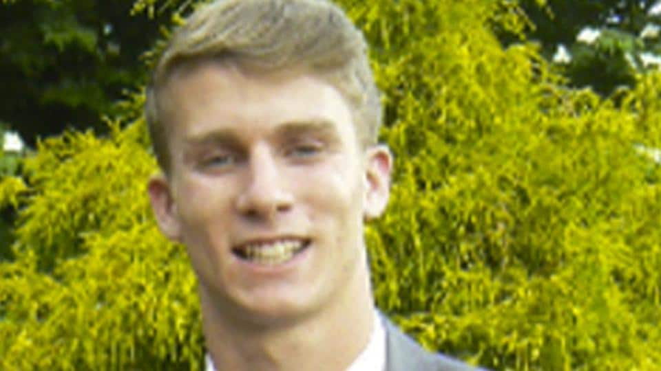 This undated photo released by the Bermuda Police Service shows American college student Mark Dombroski, who has been reported missing in Bermuda.