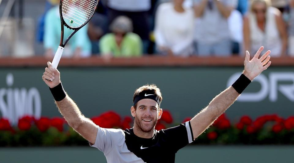 Juan Martin Del Potro celebrates match point against Roger Federer during the men's final on Day 14 of the BNP Paribas Open at the Indian Wells Tennis Garden on March 18, 2018 in Indian Wells, California.