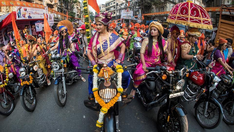 Women dress up in traditional Maharashtrian nine-yard sarees, jewellery and don turbans to participate in the rally on their bikes at Girgaum. (Pratik Chorge/HT Photo)