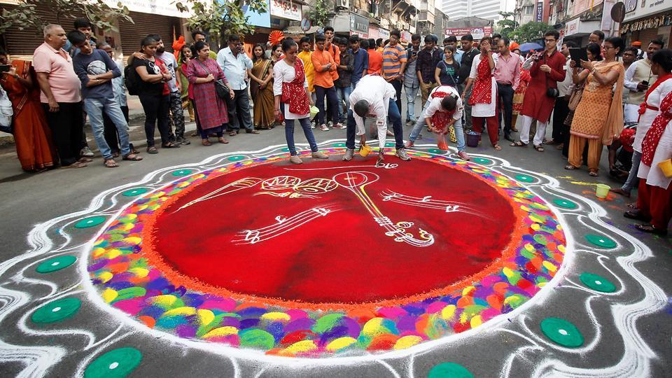 Gudi Padwa marks the traditional New Year for Maharashtrian Hindus. This year, it fell on Sunday, March 18. Here, a huge rangoli drawn at Girgaum in Mumbai. (Hemanshi Kamani/HT Photo)