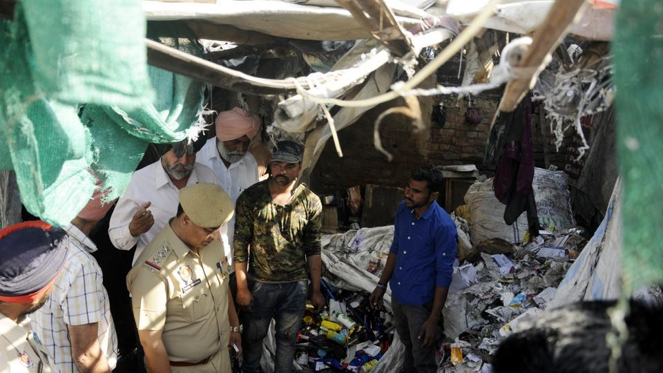 Police officials inspecting the blast site at a scrap collector's house near Sanauri Adda in Royal City of Patiala on Monday morning.