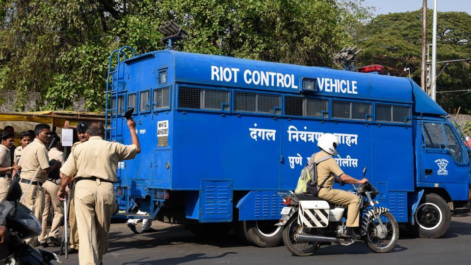 A riot control vehicle arrived at the Shivajinagar court as attempt was made to throw ink on Milind Ekbote when he was presented before a court in Pune on Monday.